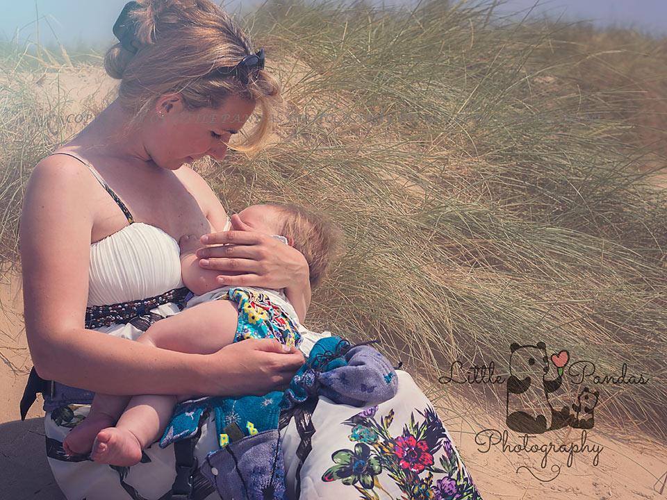 babywearing mother