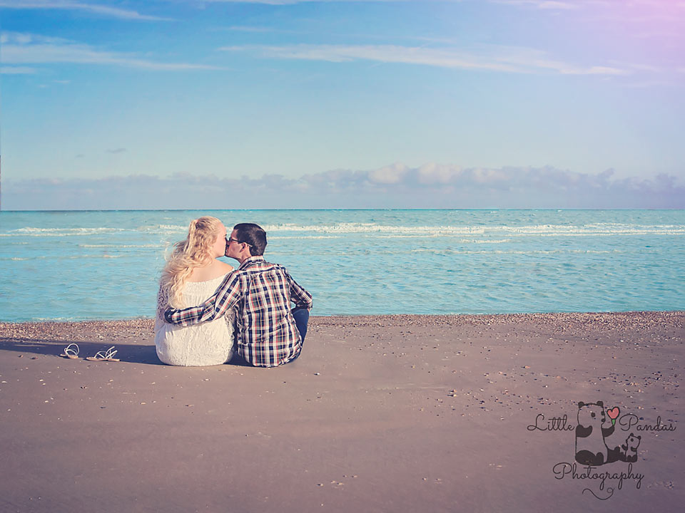 Engagement couple gazing out to sea